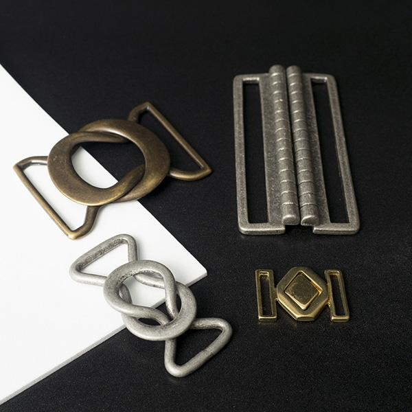 Buckles for elastic belts